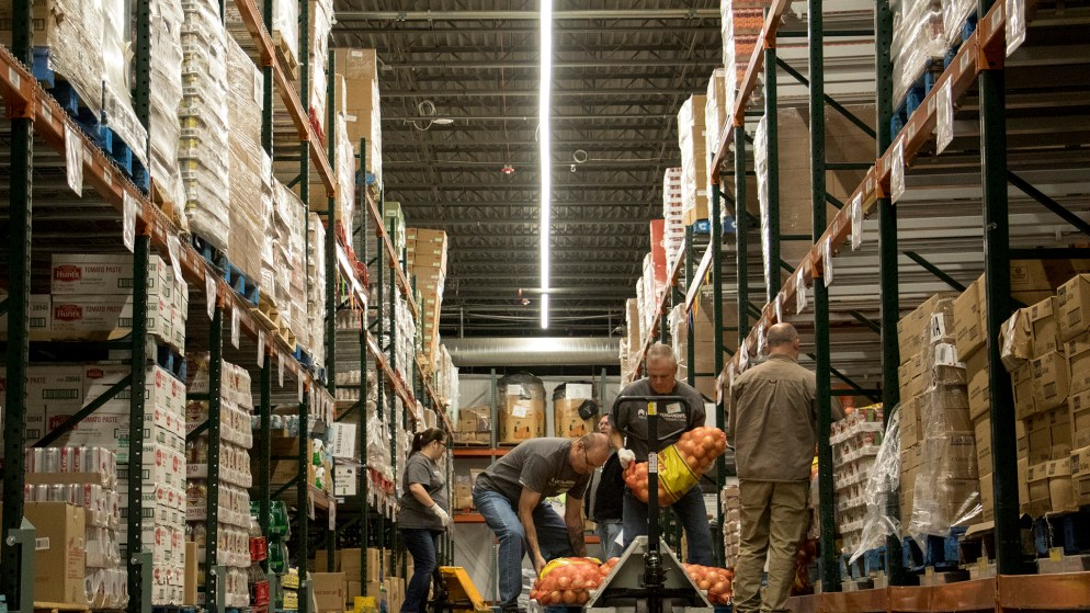 Volunteers load onions for distribution at Food Bank of the Rockies' warehouse in Aurora, Nov. 13, 2018. (Kevin J. Beaty/Denverite)