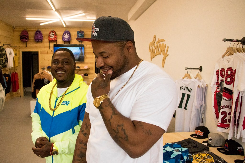 Victory Clothing Boutique co-owners Iman Saks (left) and Jarrett Beasley pose for a portrait inside their, Colorado Boulevard shop, Nov. 27, 2018. (Kevin J. Beaty/Denverite)