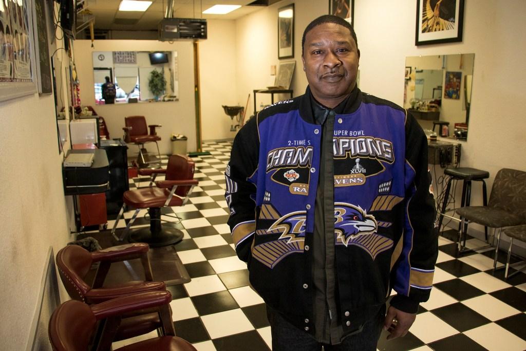 Exclusive Cuts Barber Shop owner Steve Williams poses inside his Colorado Boulevard business, Nov. 27, 2018. (Kevin J. Beaty/Denverite)