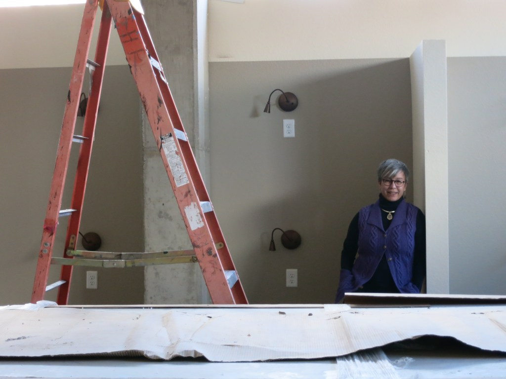 Terrell Curtis poses in a dormitory in her Delores Project's almost completed new shelter. (Donna Bryson/Denverite)