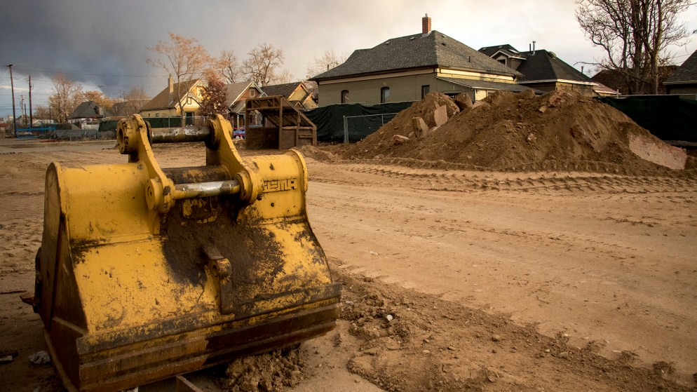 Dirt piled up at a construction site in Cole that will someday be part of the 39th Avenue Greenway project. While many residential yards around this plot were remediated as part of the I-70/Vasquez Boulevard Superfund cleanup, nonresidential areas like this were not. Dec. 1, 2018. (Kevin J. Beaty/Denverite)