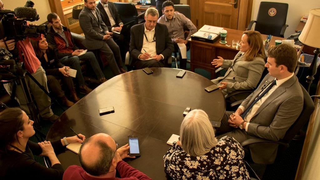 State Speaker of the House K.C. Becker and Majority Leader Alec Garnett speak with the press before the 2019 legislative session begins, Jan. 3, 2018. (Kevin J. Beaty/Denverite)