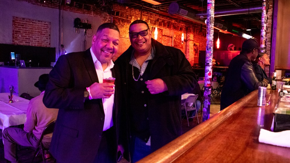 Randall Borne (left) and DJ Sonny P pose for a portrait during a fundraiser for Borne's business at Cervantes' Other Side on Welton Street, Feb. 2, 2019. (Kevin J. Beaty/Denverite)