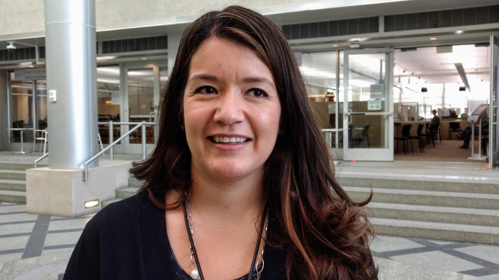Ann Padilla-Parras, a juvenile diversion officer for the Denver district attorney, shares her story of growing up in a Habitat house.  (Donna Bryson/Denverite)