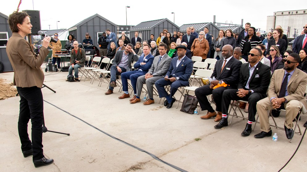 Alison George, with the State Division of Housing, speaks during a groundbreaking ceremony for an affordable housing project at 38th Avenue and Walnut Street, March 21, 2019. (Kevin J. Beaty/Denverite)