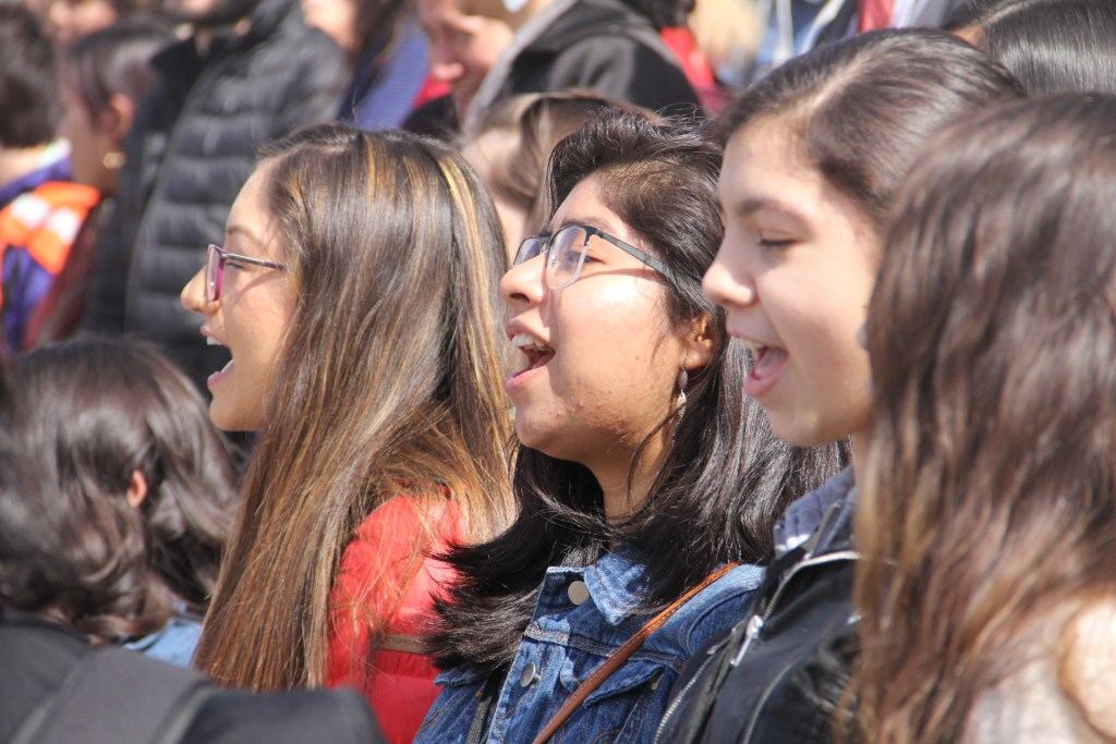 Yuma High School student Raquel Eduardo (center) chants alongside other students during a rally for Latino/a Advocacy Day on Monday, March 11, 2019, in Denver. (Esteban L. Hernandez/Denverite)
