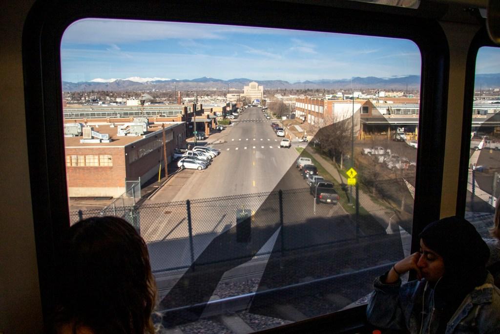 Inside an RTD train heading downtown. The Denver Streets Partnership's Amazing Denver Mobility Race, April 4, 2019. (Kevin J. Beaty/Denverite)