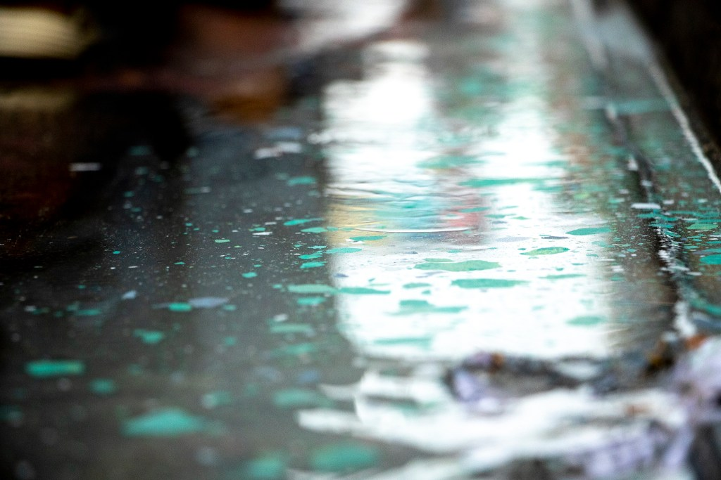 It rained over the Denver Chalk Art Festival at Larimer Square, June 1, 2019. (Kevin J. Beaty/Denverite)