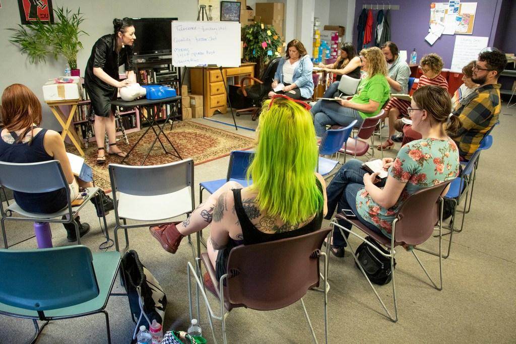Ruth Kanatser leads an overdose reversal training at the Harm Reduction Action Center, June 1, 2019. (Kevin J. Beaty/Denverite)