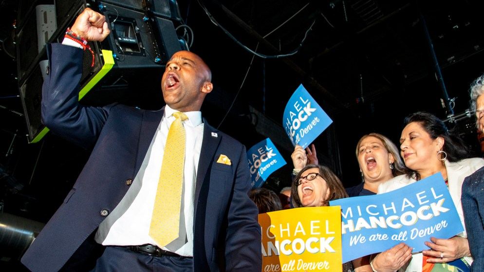 Mayor Michael Hancock walks on stage as he claims victory in the Denver mayoral race and celebrates at his election night party, June 4, 2019. (Kevin J. Beaty/Denverite)