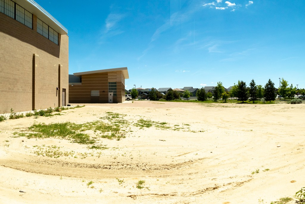 Open land adjacent to the Green Valley Ranch Recreation Center that will become a pool, June 12, 2019. (Kevin J. Beaty/Denverite)