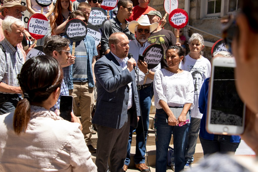 Bryce Downer, Jeanette Vizguerra's lawyer, announces bad news in her case to obtain a U-Visa outside the First Unitarian Society of Denver, June 20, 2019. (Kevin J. Beaty/Denverite)