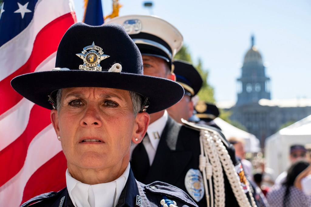 Denver Sheriff Deputy Adele Angers stands at attention before an inauguration day ceremony on the City and County Building steps, July 15, 2019. (Kevin J. Beaty/Denverite)
