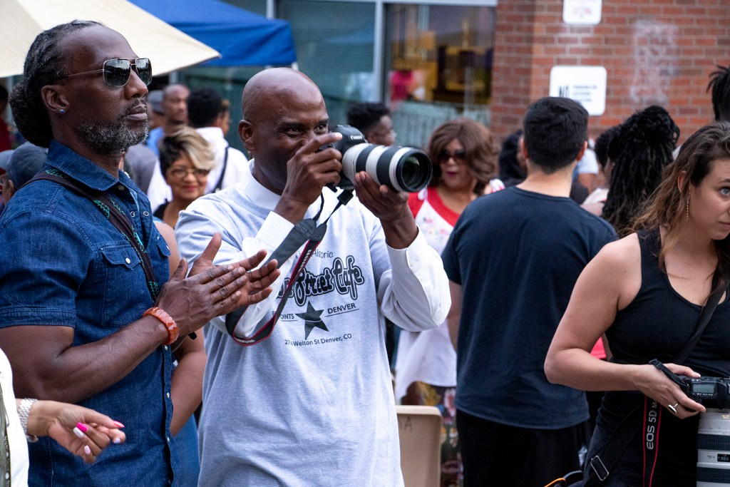 Brother Jeff Fard documents Welton Street Cafe's anniversary celebration. Five Points, July 30, 2019. (Kevin J. Beaty/Denverite)