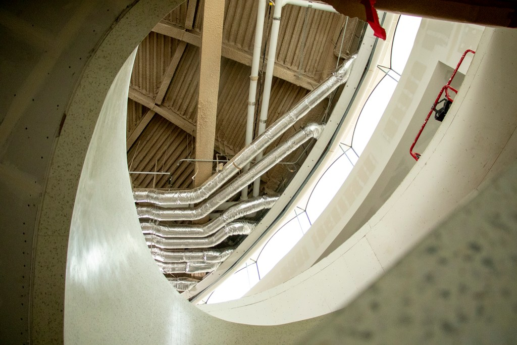 A new spiral staircase leads upstairs into the Denver Art Museum's new Martin Building. Aug. 8, 2019. (Kevin J. Beaty/Denverite)
