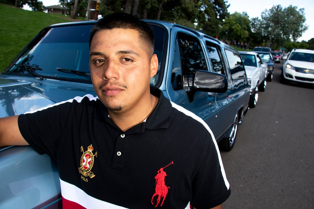 Vincent Nieto poses for a portrait with his dad's Suburban at Barnum Park, after a cruise down Federal Boulevard. Aug. 25, 2019. (Kevin J. Beaty/Denverite)