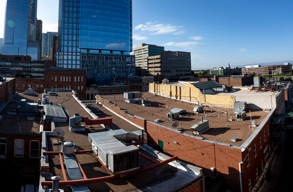 Non-green rooftops at Larimer Square that one day will house gardens. Aug. 17, 2019. (Keivn J. Beaty/Denverite)