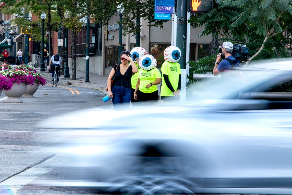 CDOT eyeballs stand at a Speer Boulevard corner to promote eye contact awareness, Sept. 4, 2019. (Kevin J. Beaty/Denverite)