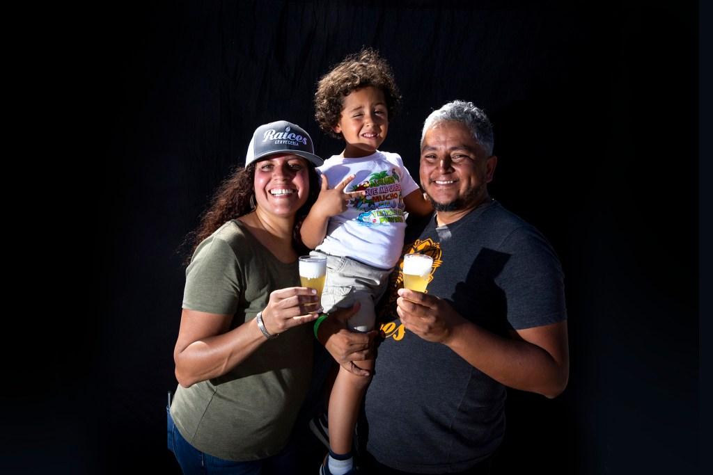 Tamil Maldonado, Jose Beteta of Raíces Brewing Co. with their son, Arani. Suave Fest, by the future site of Raices Brewing, Sept. 14, 2019. (Kevin J. Beaty/Denverite)