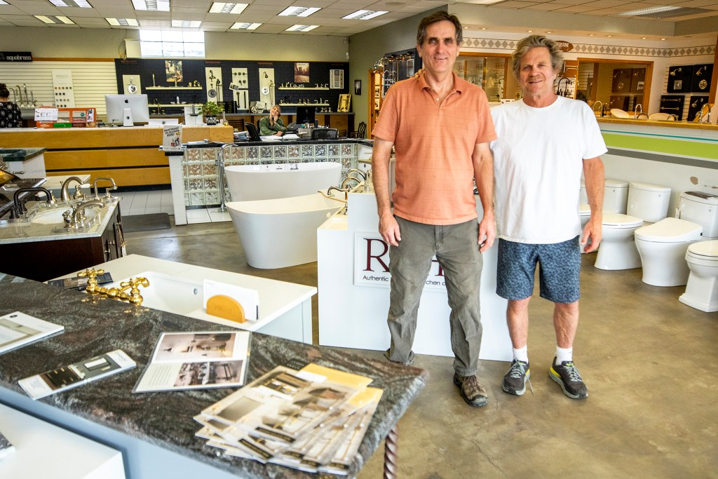 Robert and Rick Hall pose for a portrait in their Brighton Boulevard business, Do-It-Ur-Self Plumbing. Sept. 18, 2019. (Kevin J. Beaty/Denverite)