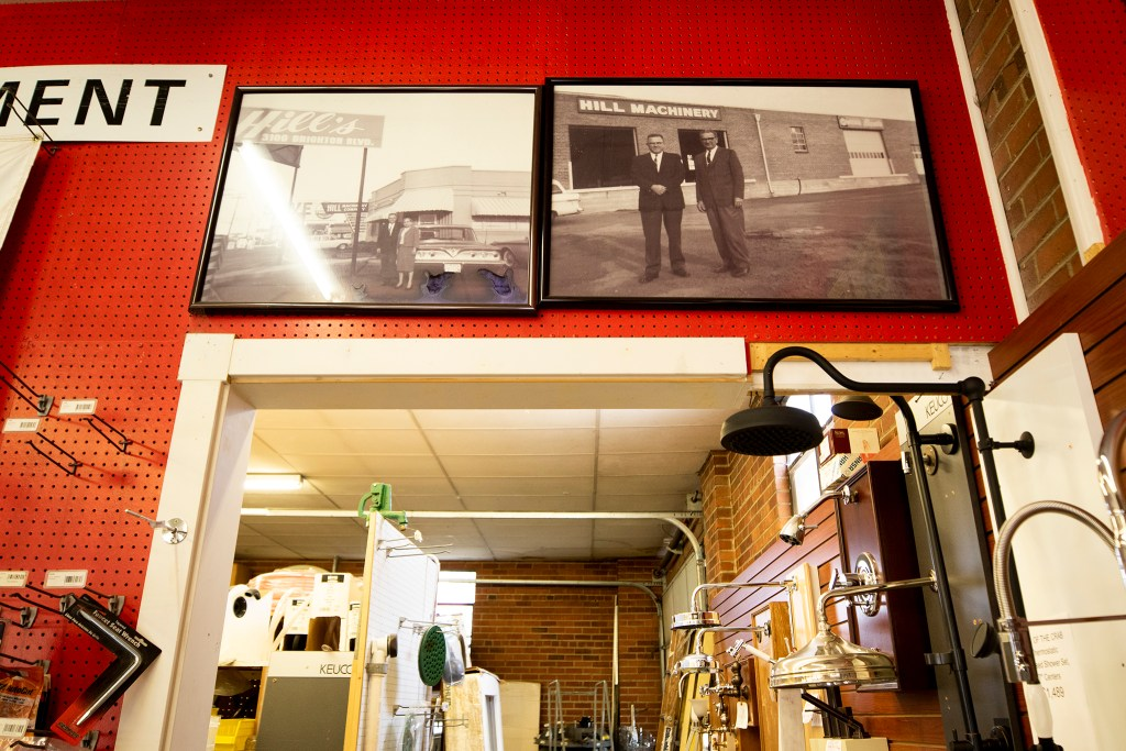 Portraits of Robert and Rick Hill's father in front of his Brighton Boulevard business, Hill Machinery, in the building now housing their plumbing shop. Sept. 18, 2019. (Kevin J. Beaty/Denverite)
