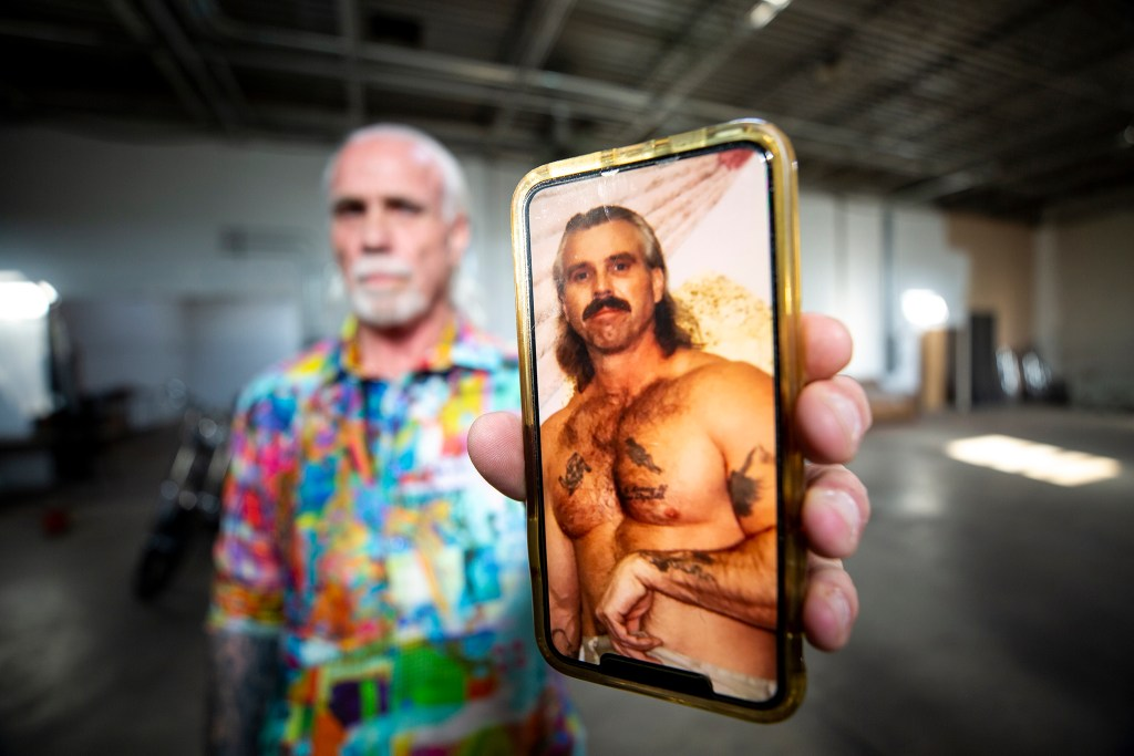 """Accidental developer"" Bernard Hurley shows a photo of what he looked like before he went to prison. Sept. 24, 2019. (Kevin J. Beaty/Denverite)"