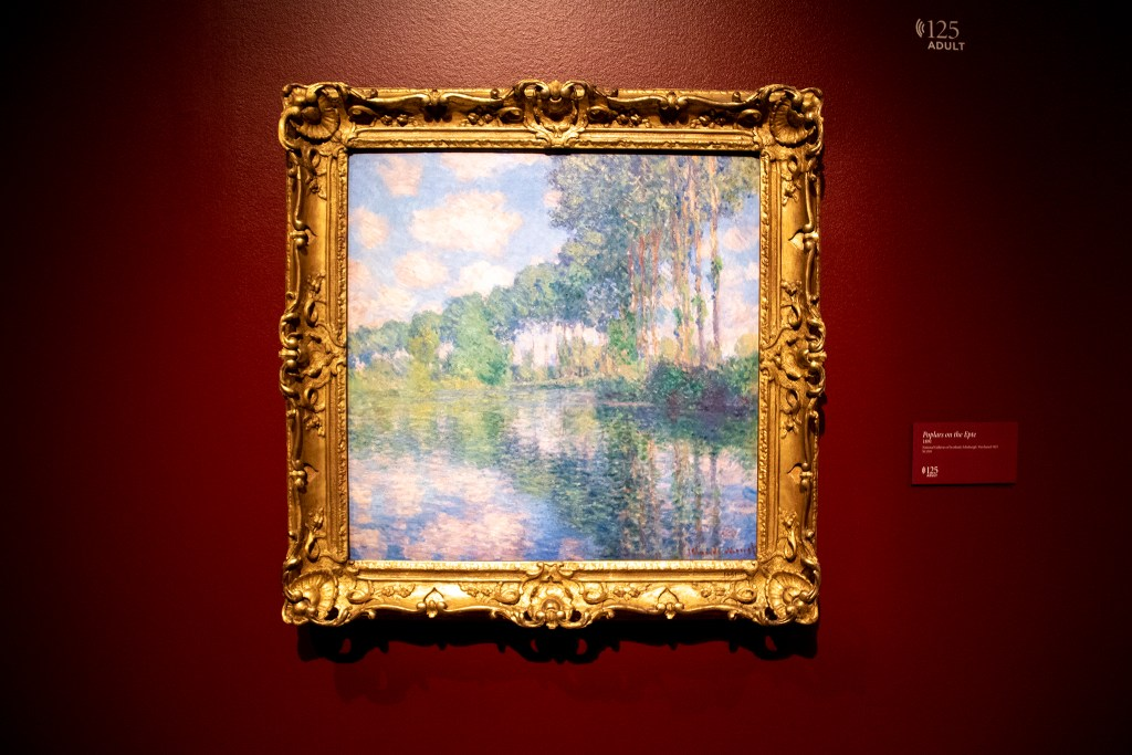 """Poplars on the Epte"" on display in the Denver Art Museum's ""Claude Monet: The Truth of Nature"" exhibit Oct. 17, 2019. (Kevin J. Beaty/Denverite)"