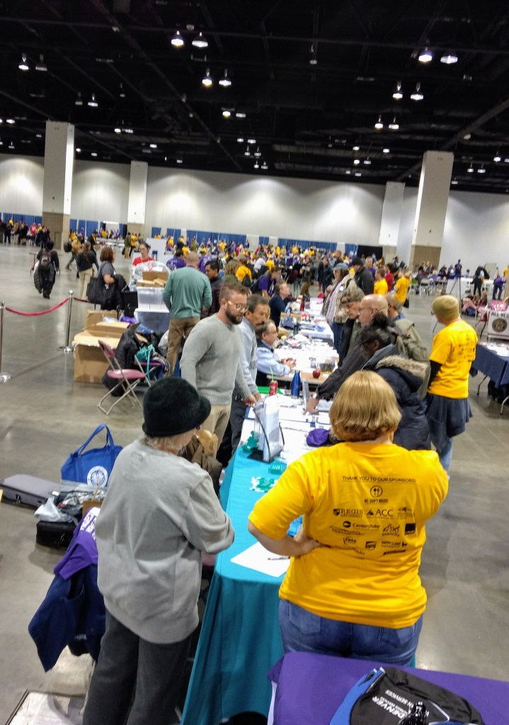 Officials from the VA and other agencies offered connections to housing, mental health and help navigating military benefits at Project Homeless Connect Denver on Oct. 10, 2019. (Donna Bryson/Denverite)