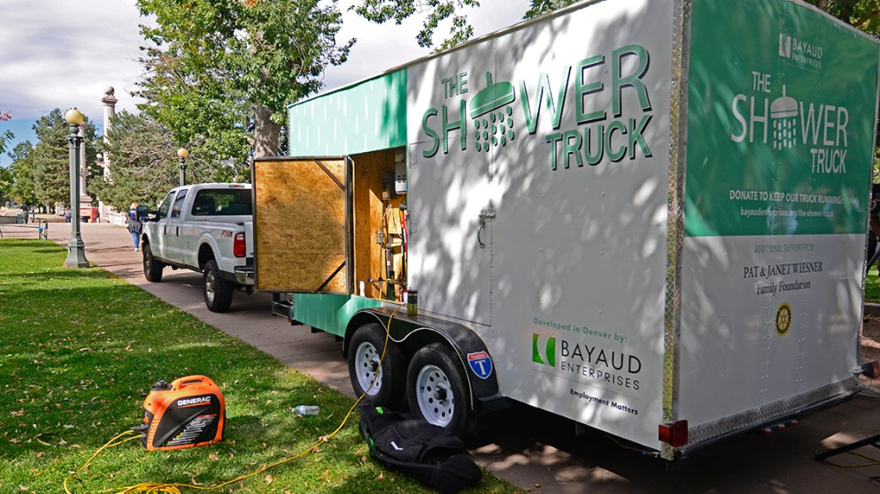 Bayaud Enterprises launched a new shower truck for people experiencing homelessness in Civic Center Park on Wednesday, Oct. 9, 2019.