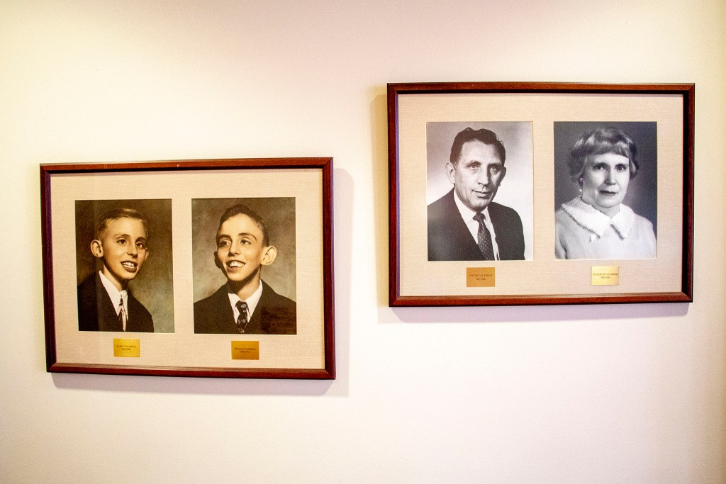 Photos of Larry, Donald, Joseph and Elizabeth Calabrese (left to right) on the walll of the support center they founded, Laradon in Globeville. Nov. 8, 2019. (Kevin J. Beaty/Denverite)
