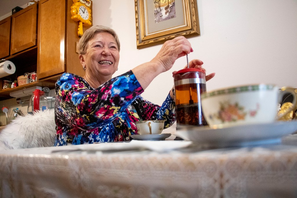 Alla Sheherbi makes tea in her home at Windsor Gardens, Nov. 16, 2019. (Kevin J. Beaty/Denverite)