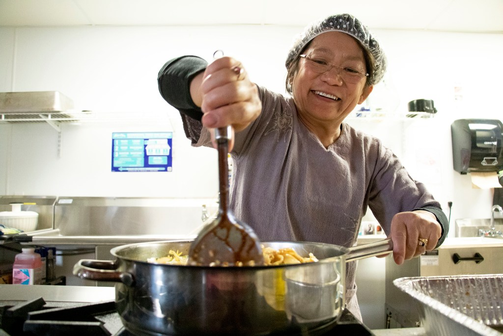 Kitaya Lindsay makes pad thai The Co-Op at 1st in Barnum West, Nov. 20, 2019. (Kevin J. Beaty/Denverite)