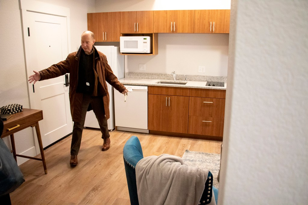 Developer David Zucker gives a tour of the Quayle apartments on Broadway, Nov. 21, 2019. (Kevin J. Beaty/Denverite)