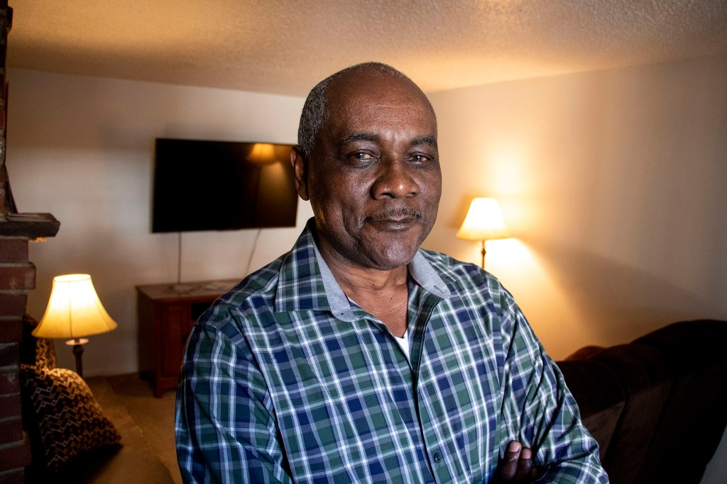 William Dawson poses for a portrait inside his Aurora apartment, Jan. 7, 2020. (Kevin J. Beaty/Denverite)