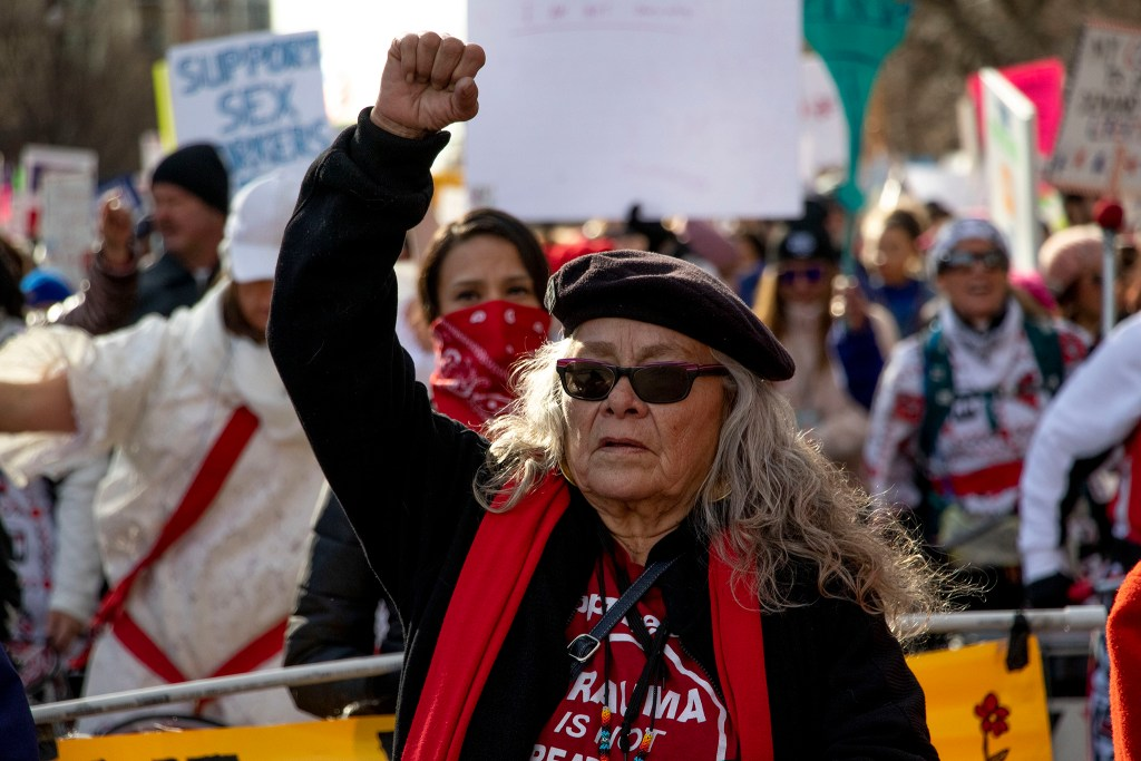 Charmaine Shark Barrows raises a fist during the Denver Womxn's March, Jan. 18, 2020. (Kevin J. Beaty/Denverite)