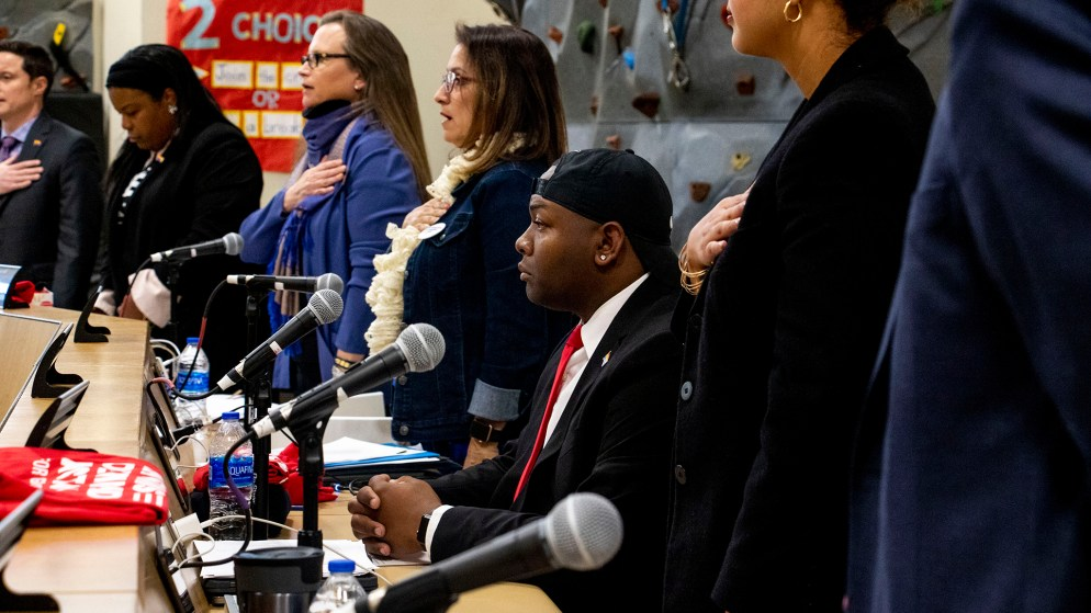 Tay Anderson was the only Denver School Board member not to stand during the Pledge of Allegiance, Jan. 23, 2020. (Kevin J. Beaty/Denverite)