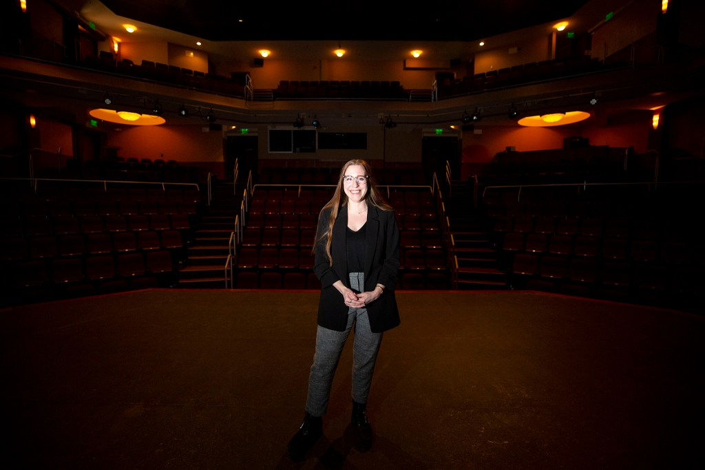 Denver Jewish Film Festival director Amy Weiner Weiss poses for a portrait on stage at the Denver Jewish Community Center's Wolf Theater. Jan. 28, 2020. (Kevin J. Beaty/Denverite)