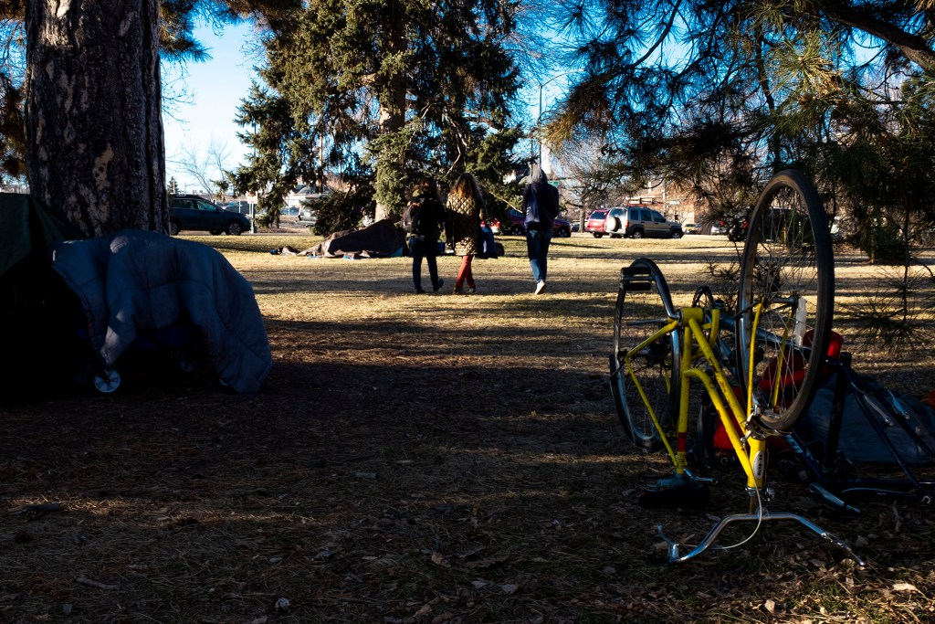 Samantha Camerino, Stephanie Kaufman and Ben Grossman walk through City Park looking for people to interview for the annual Point in Time Survey of Denver's unhoused population. Jan. 28, 2020. (Kevin J. Beaty/Denverite)