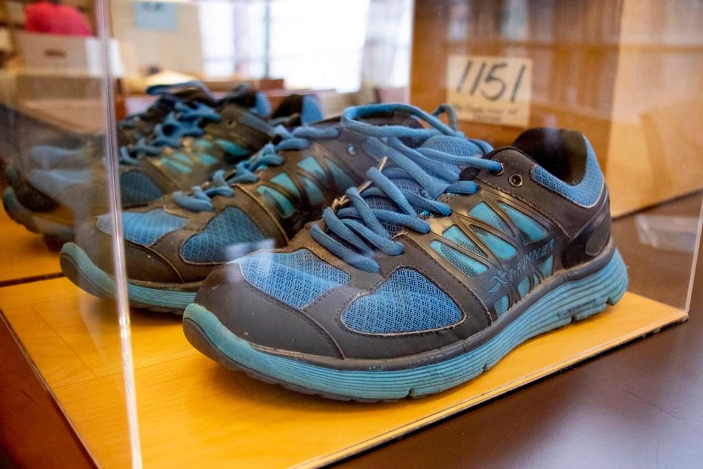 Gov. Jared Polis' campaign-trail sneakers inside a protective plexiglass box. History Colorado Center, Feb. 3, 2020. (Kevin J. Beaty/Denverite)