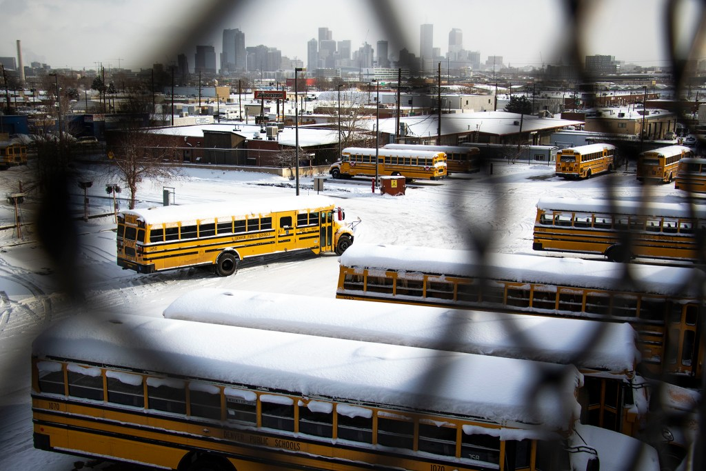Denver Public Schools buses on a snowy day, Feb. 4, 2020. (Kevin J. Beaty/Denverite)