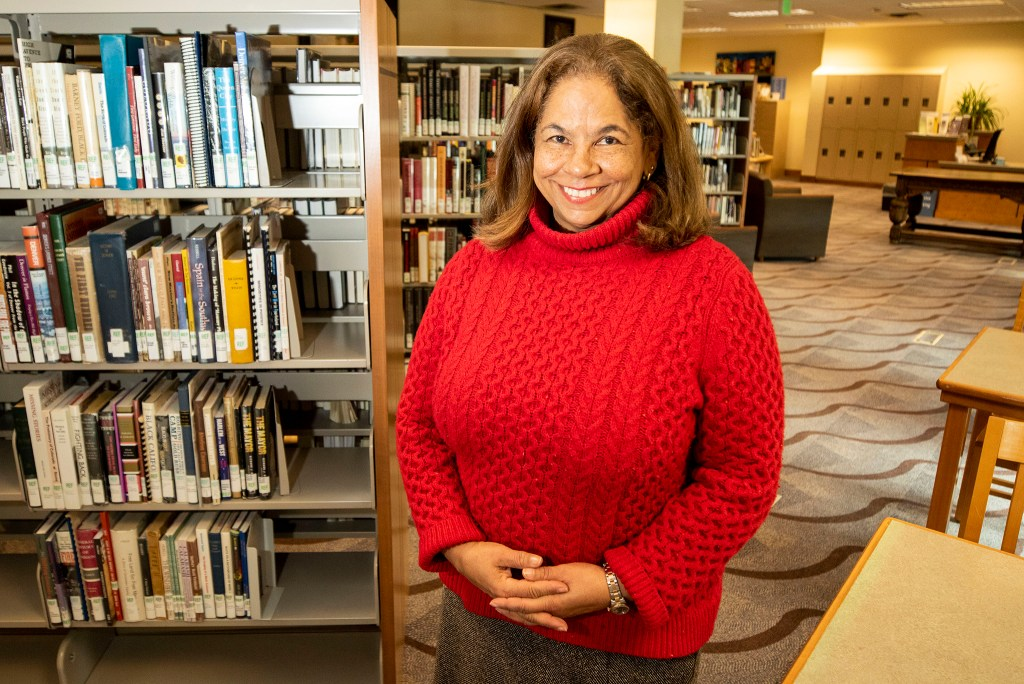 Dr. Renee Cousins King poses for a portrait inside the Blair-Caldwell African American Research Library. Feb. 18, 2020. (Kevin J. Beaty/Denverite)