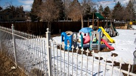A kiddie playground in a yard next to Westwood Park, Feb. 18, 2020. (Kevin J. Beaty/Denverite)