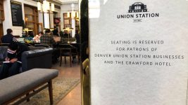 A new sign at Denver Union Station forbids people who haven't spent money there from sitting, Feb. 24, 2020. (David Sachs/Denverite)