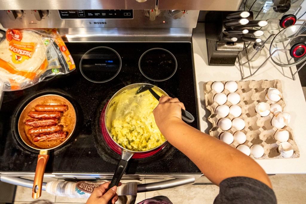 Christina Zaldivar makes her kids breakfast burritos for lunch. March 7, 2020. (Kevin J. Beaty/Denverite)