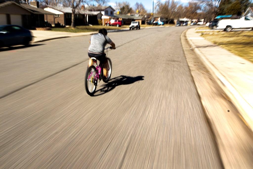 Francysco Zaldivar races his bike near his home in Bear Valley. March 7, 2020. (Kevin J. Beaty/Denverite)