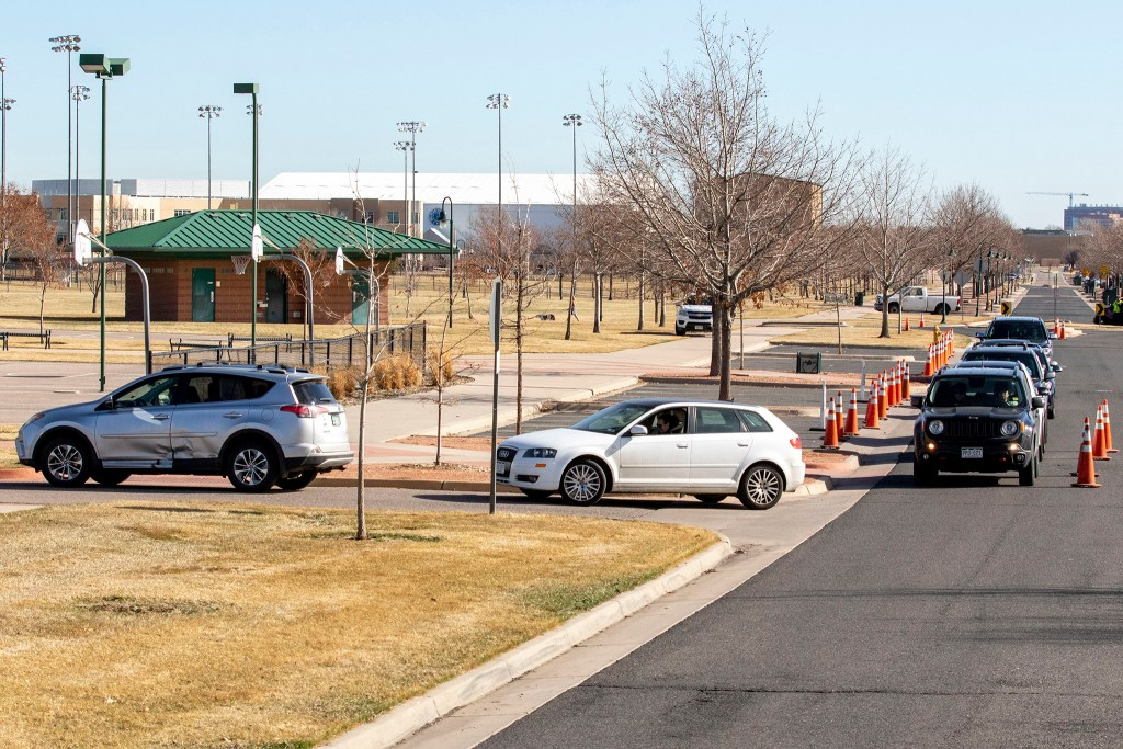 Cars line up as people wait to be tested at the Colorado Department of Health and Environment's COVID-19 testing station in Lowry. March 11, 2020. (Kevin J. Beaty/Denverite)