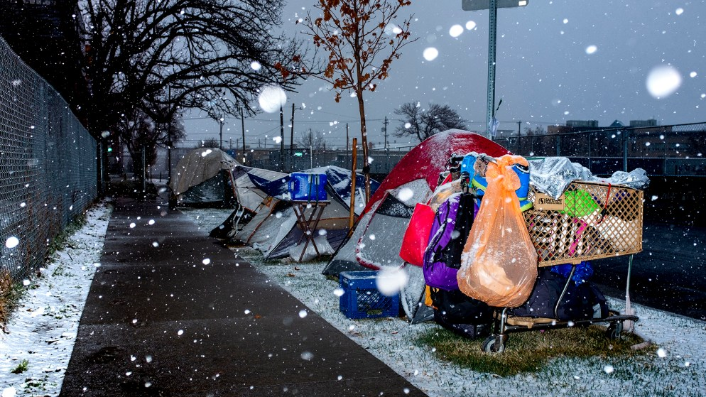 People hunker down in tents on a cold morning in Five Points as shelters brace for the possibility of COVID-19 infections in their facilities. March 19, 2020. (Kevin J. Beaty/Denverite)