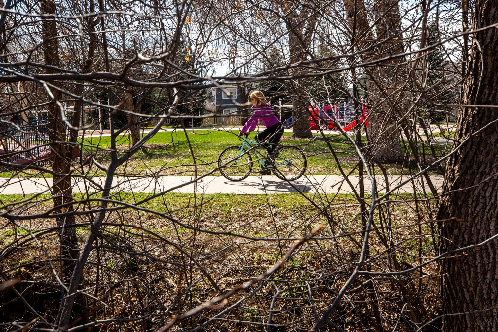 Debbie Fox rides her bike near her home in Arvada. March 26, 2020. (Kevin J. Beaty/Denverite)
