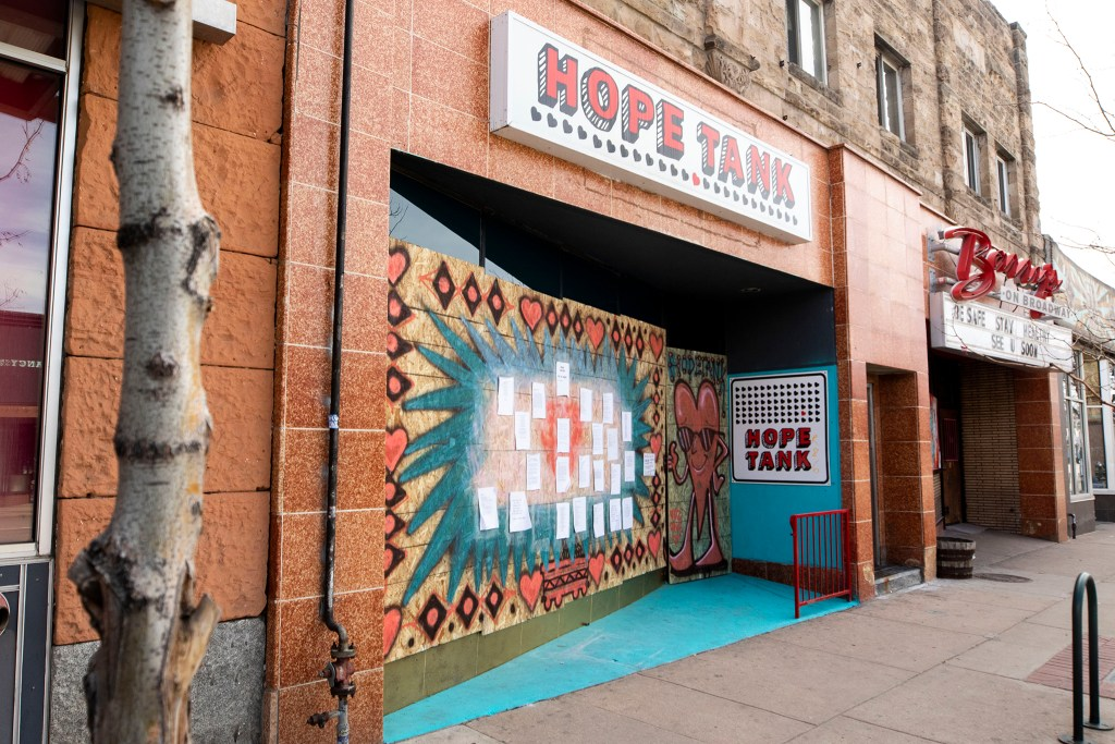 Hope Tank on Broadway is boarded up, but covered with paint and poems, April 1, 2020. (Kevin J. Beaty/Denverite)