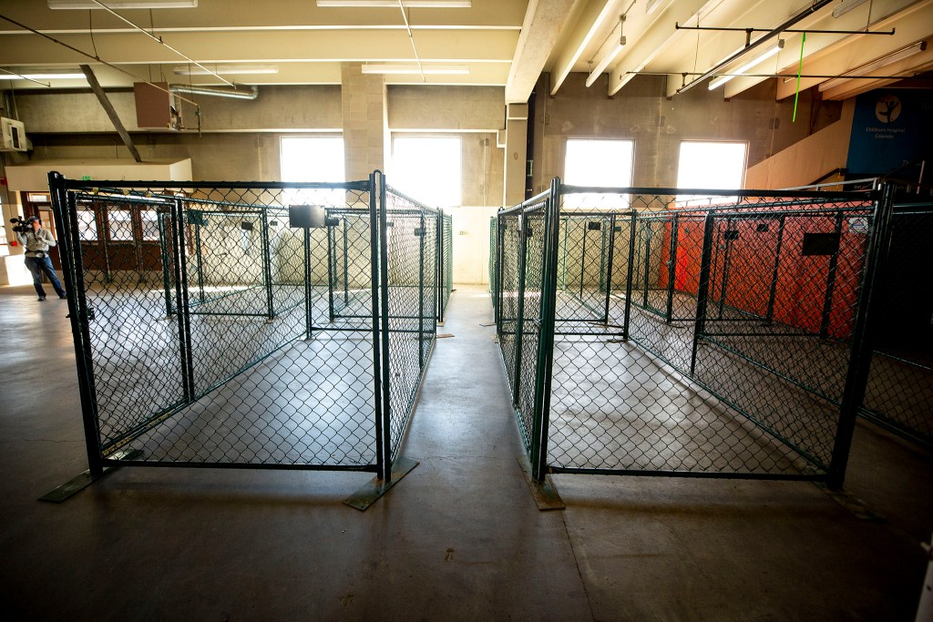 Pens for pets inside the National Western Complex, which will become a shelter for unhoused men. April 8, 2020. (Kevin J. Beaty/Denverite)